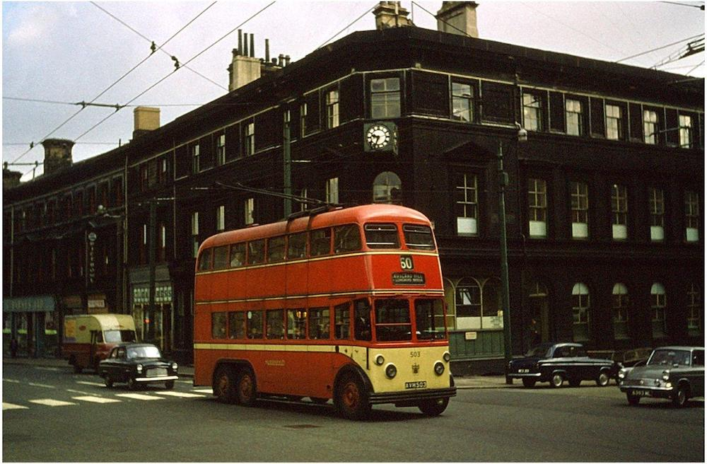 Trolleybus passes the transport offices in Huddersfield