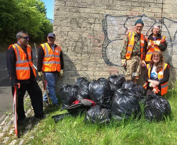 Clean-up team with the collected bags.